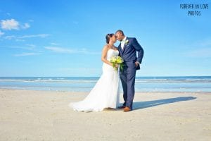 Daytona Beach Weddings can take place behind your beach wedding hotel, like this beautiful couple had.