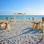 Our Clearwater Beach Weddings include a natural bamboo canopy, chairs, and an elegant aisle-way.