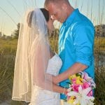 Siesta Key Beach Weddings not only provide you with beautiful Gulf water, but check out these dunes as the bride and groom pose in front of them.