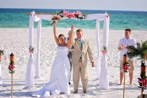 Destin Beach Weddings that will include white bamboo canopy and floral topper.
