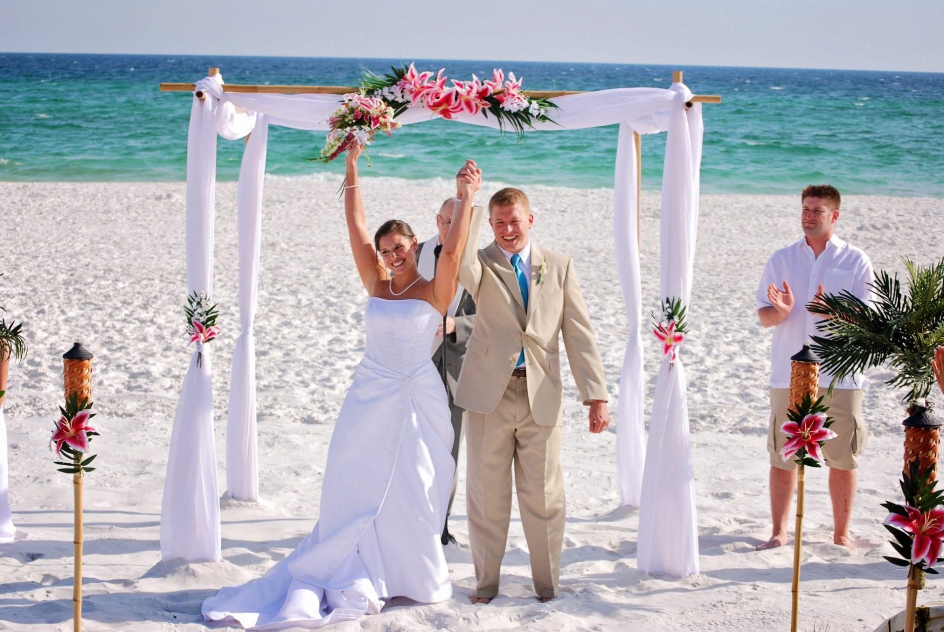 Couple puts hands up after Gulf beach wedding in Destin, FL