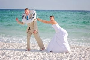 Destin Beach Weddings with a fun photography session and just married ring