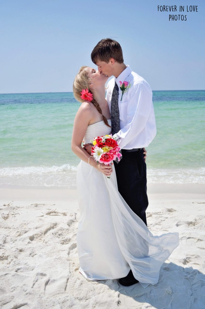 Couple kissing after Destin Gulf Beach Wedding ceremony