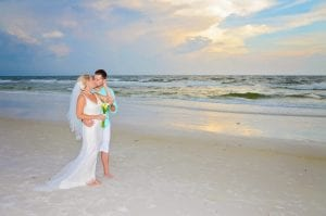 A bride holds her groom after our Siesta Key Beach Weddings.