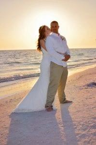 A bride hugs her groom after they celebrated their Siesta Key Beach weddings.