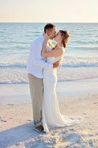 A bride and groom share an intimate kiss from our Siesta Key Beach weddings.