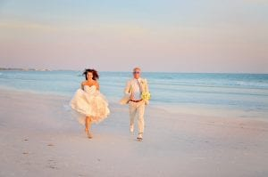 Siesta Key Beach Weddings are meant to be fun and relaxing. Check out this bride and groom running down the private Siesta Key Beach.