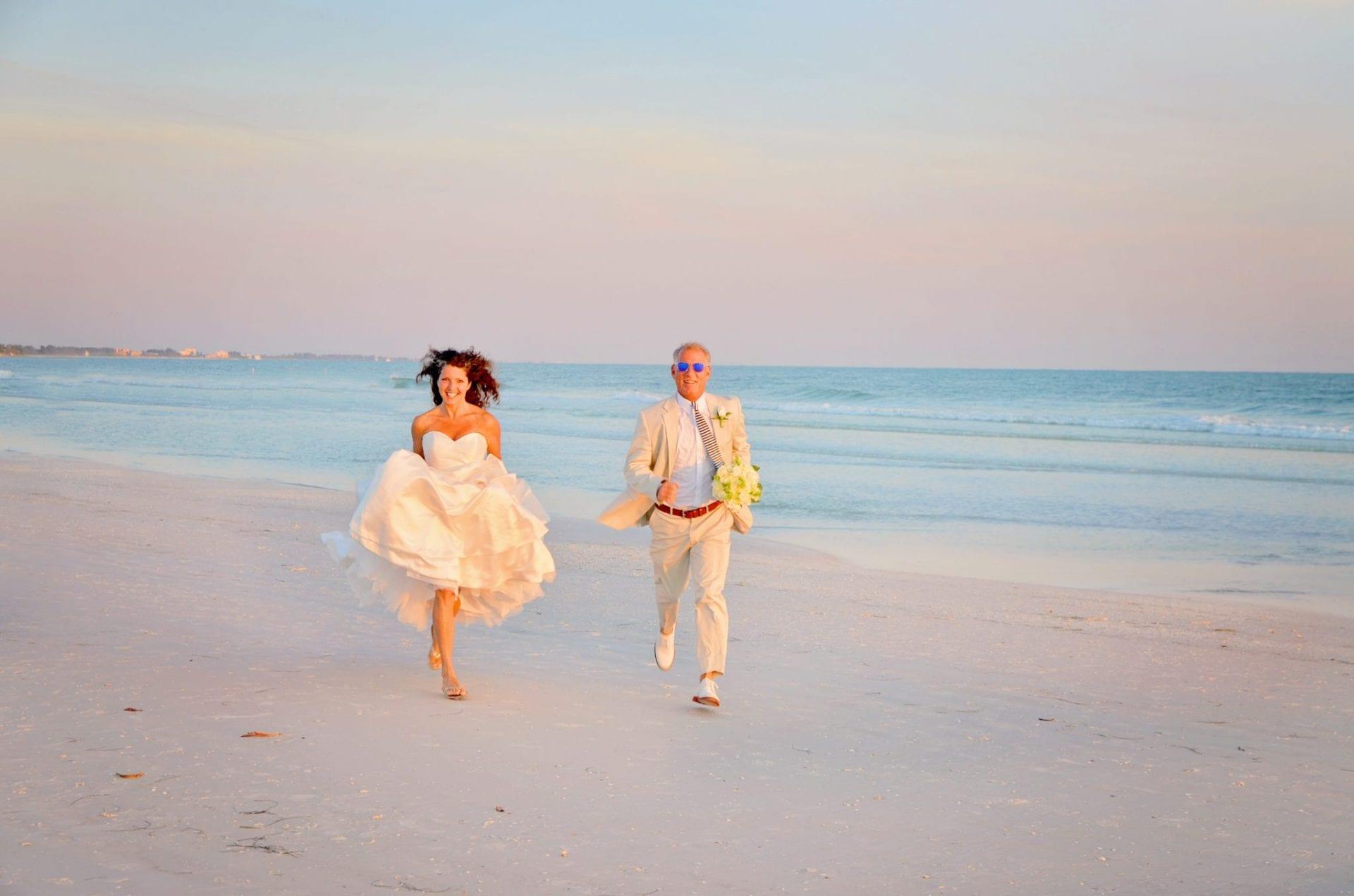 Siesta Key Beach Wedding couple running on the sand