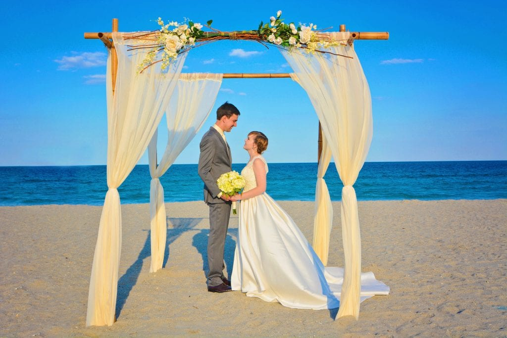 Weddings in Florida with a natural bamboo canopy.