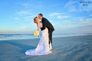 A groom dips his bride during one of our Daytona Beach Weddings in Florida.