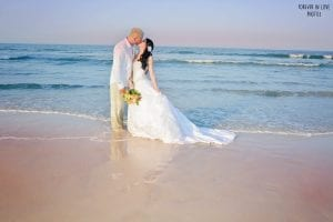 Daytona Beach Weddings during the sunset hour make for a beautiful sunset sky and blue ocean.