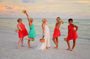 Siesta Key Beach Weddings bridal party style of unique and different colored bridal party gowns.