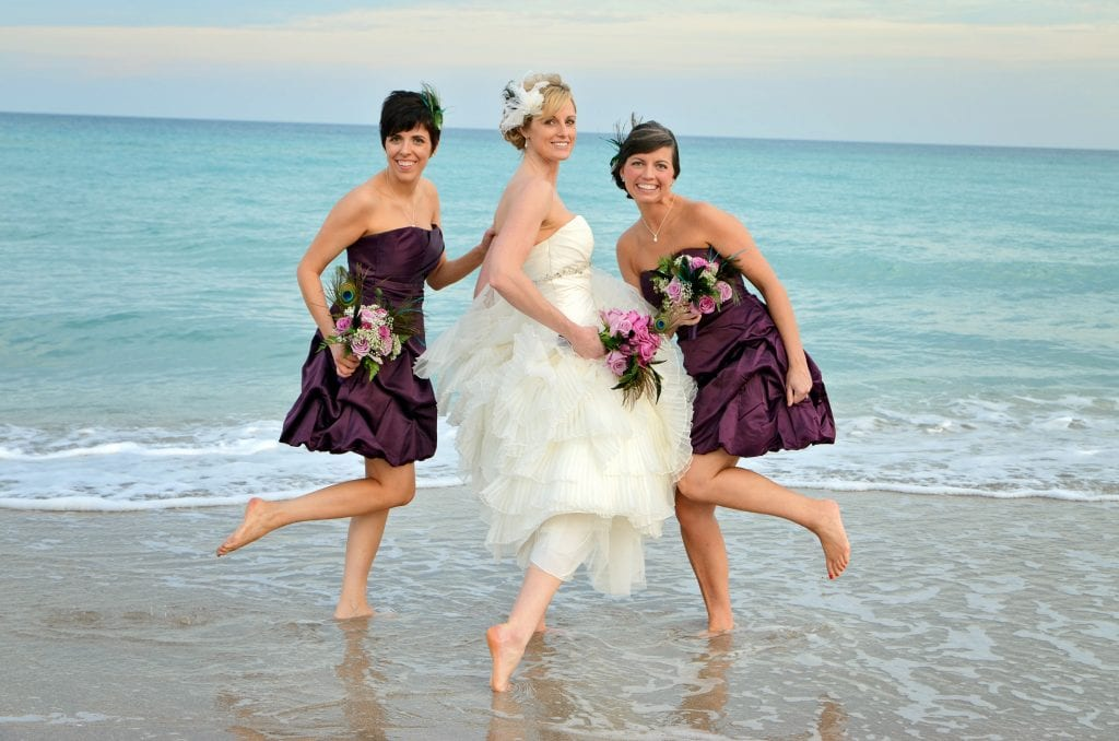 Miami beach wedding bride with bridesmaids in the sea
