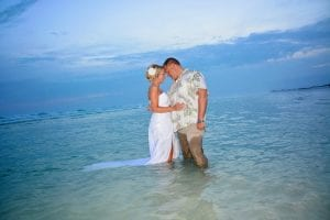 This bride and groom share glances during their trash the dress session of our Siesta Key Beach Weddings.