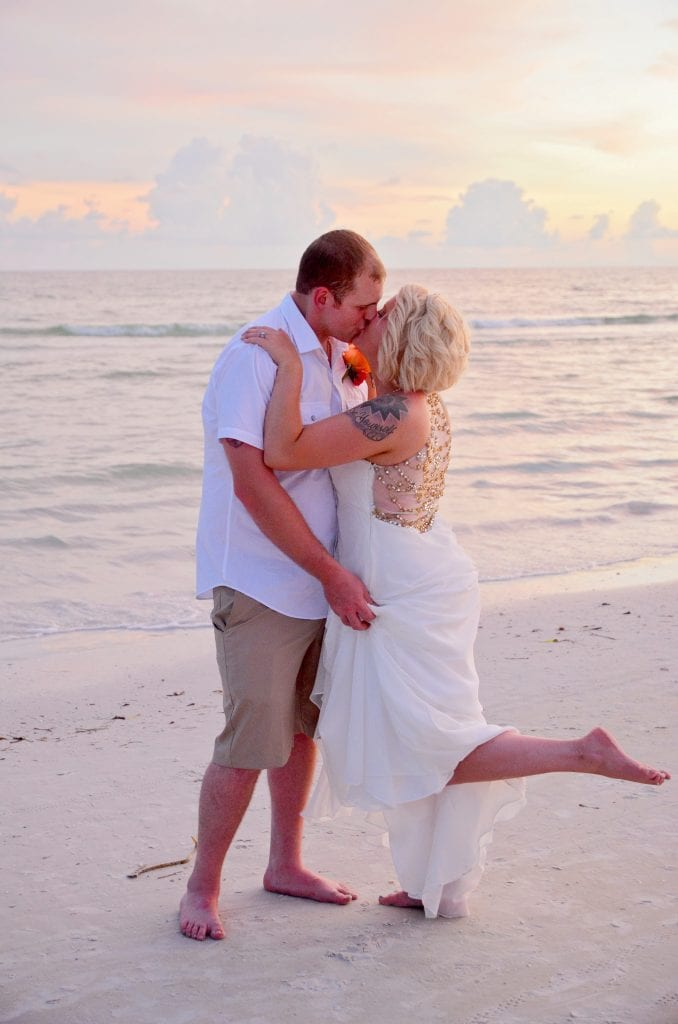 Siesta Key Beach Weddings are complete with this beautiful beach wedding dress and groom attire.