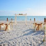 Destination Weddings in Florida offers this elegant natural look with chairs, canopy, chalkboard and more.