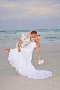 Siesta Key Beach Weddings are the ideal spot for this groom to dip his bride.