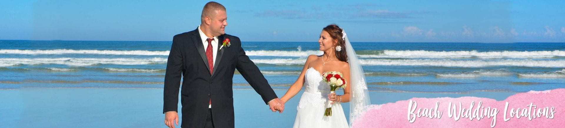 Wedding couple holding hands on the beach