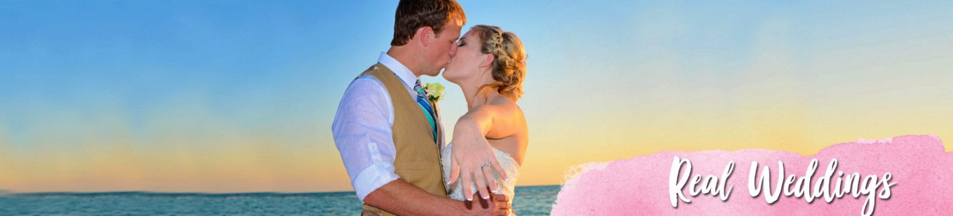 Headshot of wedding couple kissing at beach