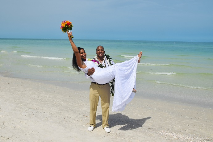 Groom picks up bride on Gulf beach at St. Pete