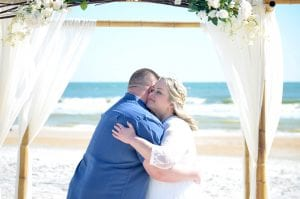 Nothing is sweeter than this hug after their first kiss during one of our Florida Beach Elopements.
