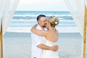 With all of our Florida Beach Elopements, you can add a first dance under the bamboo canopy. This bride and groom share a sweet first dance on the beach together.