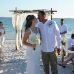 this bride and groom share a moment at the end of the aisle during on of our weddings in Florida.
