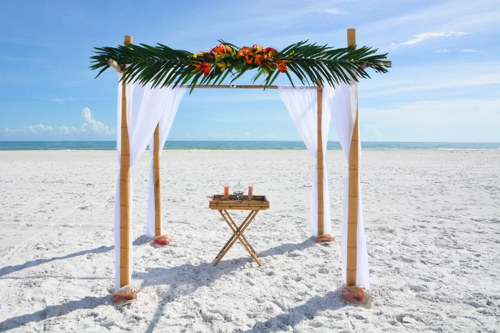 Small Florida Beach Weddings with tropical decor and bamboo canopy.