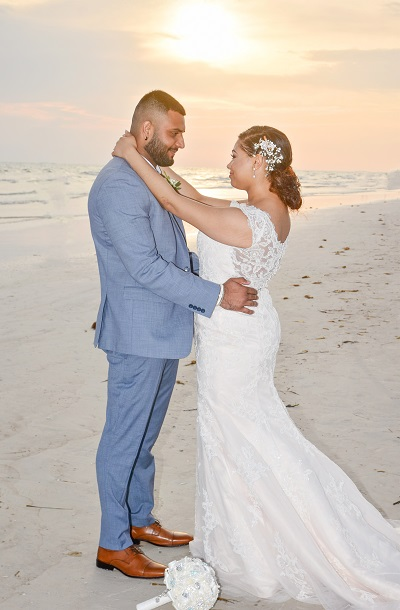 Couple gazes at each other at sunset after Siesta Key Beach wedding