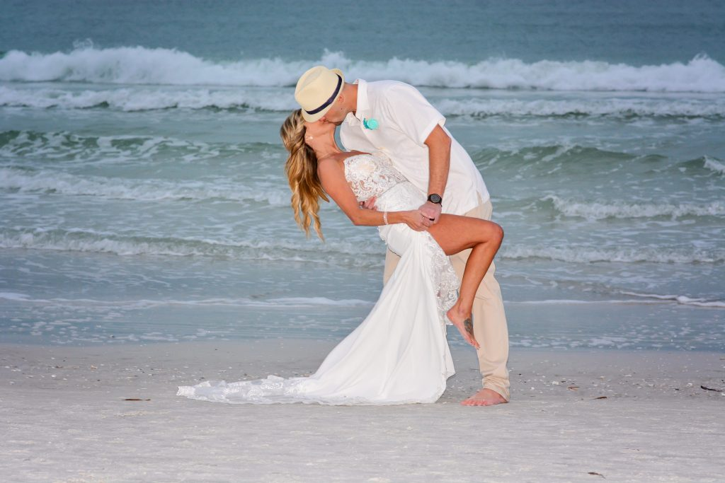 Siesta Key couple kissing in the ocean