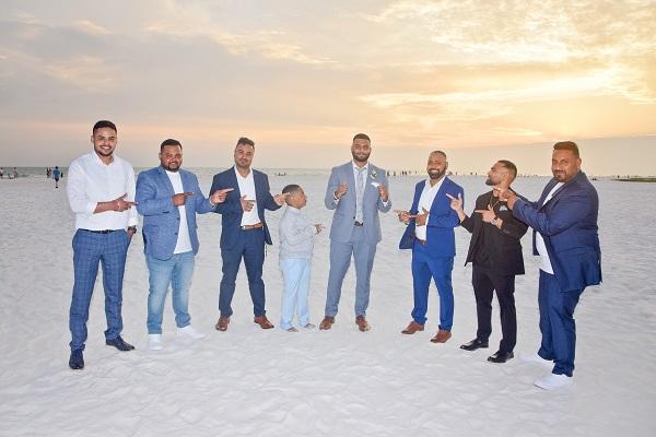 Groomsmen point at groom on Siesta Key Beach