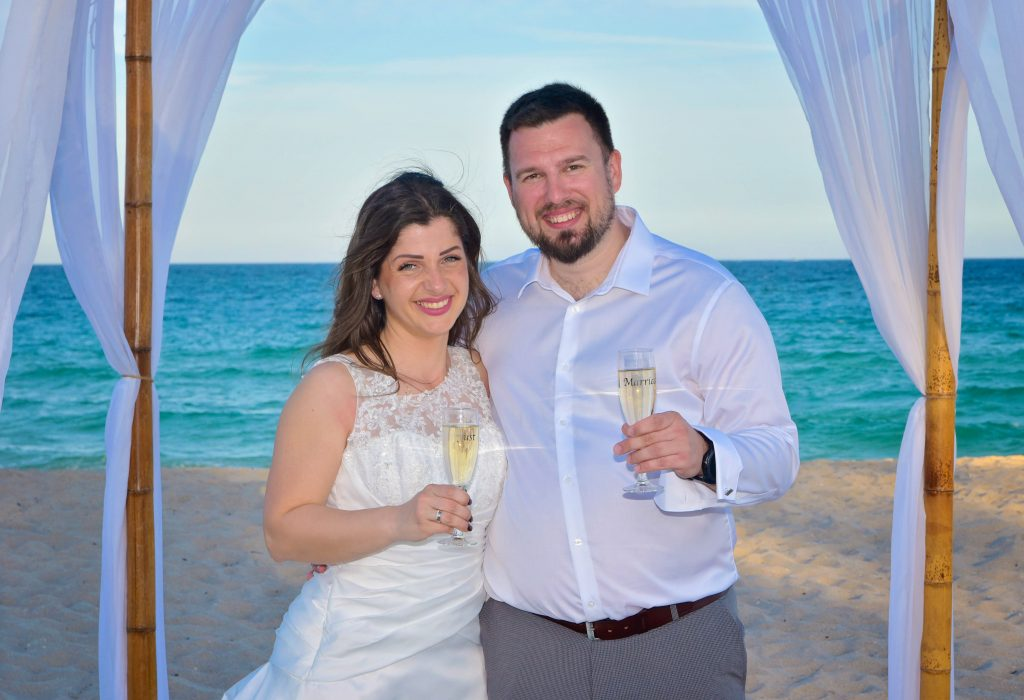 Couple toasting after beach wedding Florida
