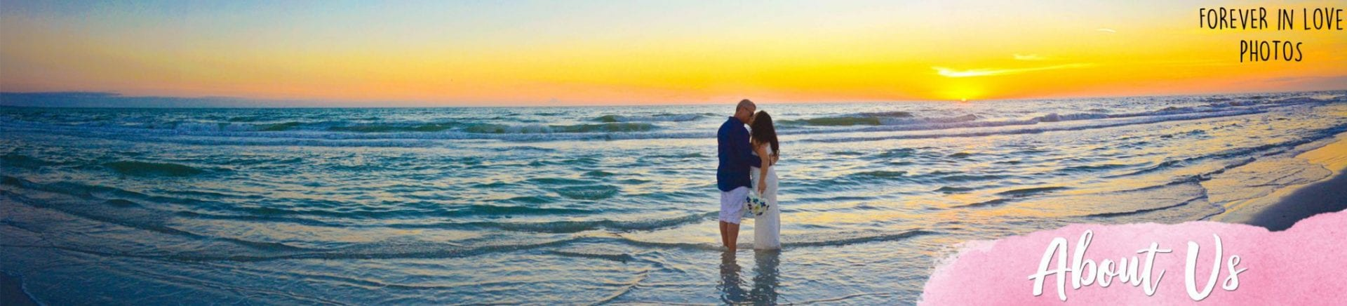Married couple kissing in the ocean