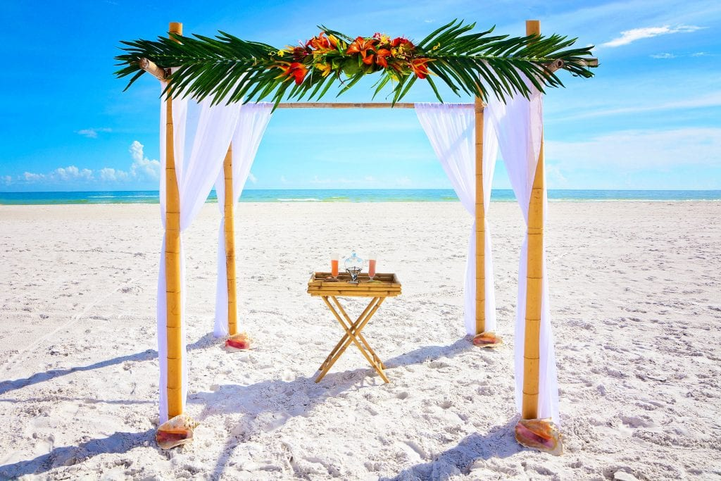 Tropical bamboo wedding arch with canopy on the beach in Florida.