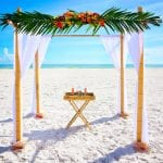 Small Florida beach Weddings with a tropical bamboo canopy on the beach.