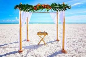Small Florida beach Weddings with a tropical bamboo canopy on the beach.
