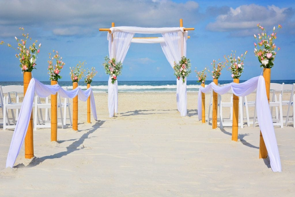 Florida Beach Weddings complete with floral beach wedding canopy.