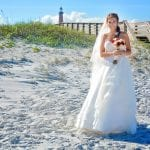 Ponce Inlet Beach Wedding bride walks down sand to altar