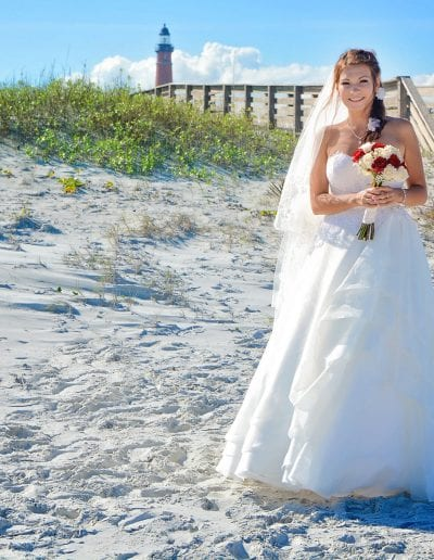 Ponce Inlet Beach Wedding bride walks down sand to altar