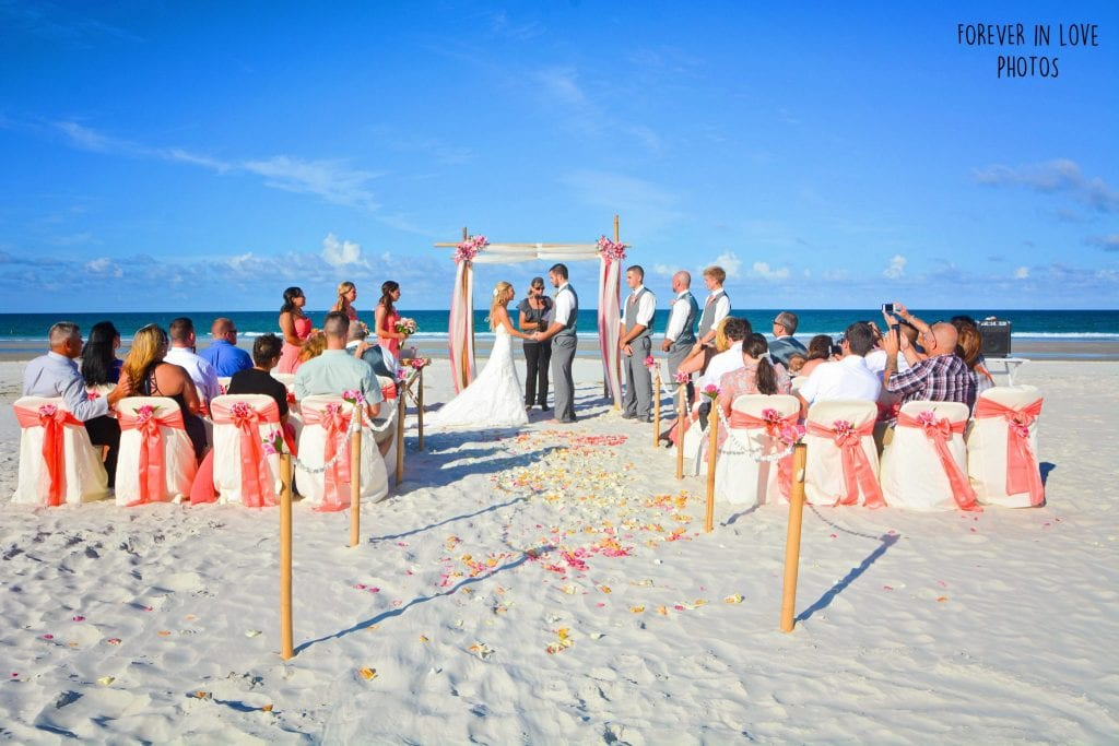 Daytona Beach Weddings and Ponce Inlet Beach Weddings with bamboo canopy, coral material, coral beach decor and chairs.