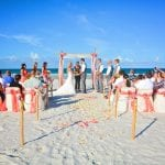 Ponce Inlet Beach Weddings with bamboo canopy, coral material, coral beach decor and chairs.