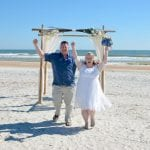 A bride and groom celebrate their elopement during one of our Anastasia State Park Weddings.
