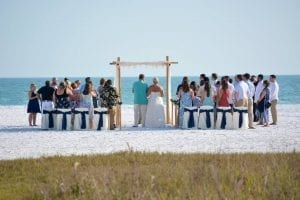 Siesta Key beach weddings with a bamboo canopy and chairs at Siesta Key Public Beach.