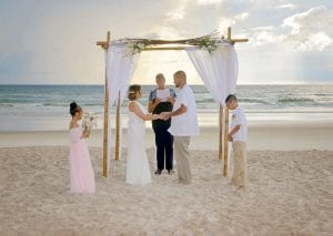 A bride and groom elope during one of our Siesta Key beach weddings surrounded by their children.