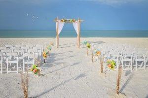 Pastel Florida beach wedding packages with pastel floral arrangements