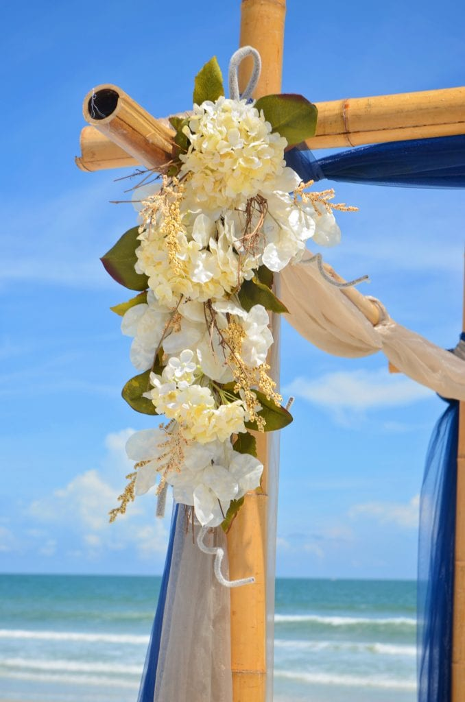 Beautiful Floral arrangement on the bamboo canopy as part of our Beach Packages in Florida.