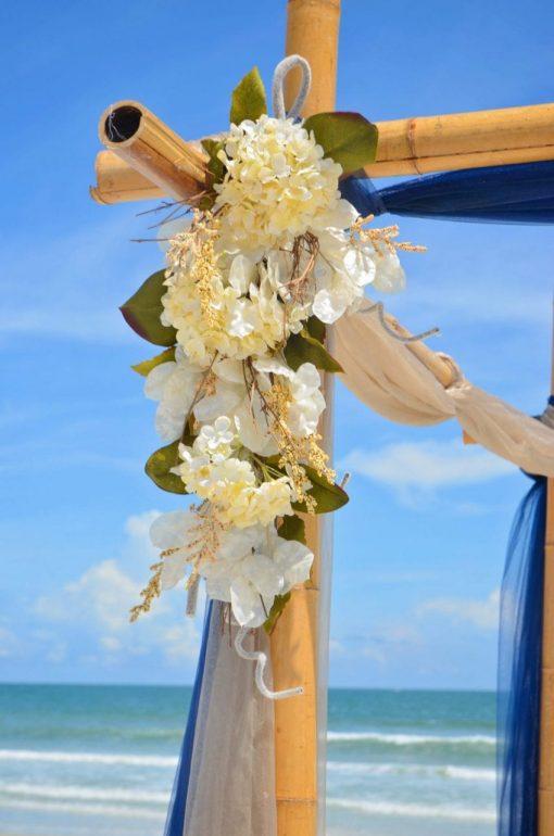 Flowers on wedding arch at beachside wedding in Florida