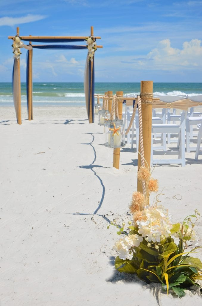 Beach Packages in Florida with starfish lantern aisle-way and beach wedding decor.