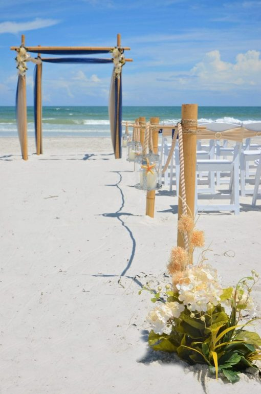Aisleway and beach wedding arch before ceremony