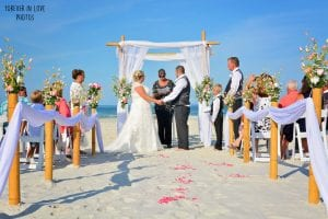 This couple exchanges vows under and elegant Floral Distinctive Wedding Package set up at one of our Wedding Packages in Florida.